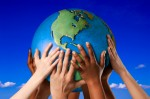 Many hands on a globe